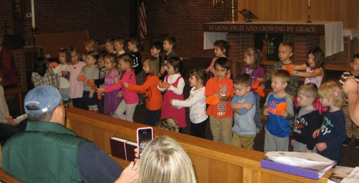 Students singing in church