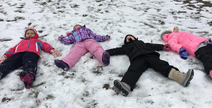 Friends making snow angels