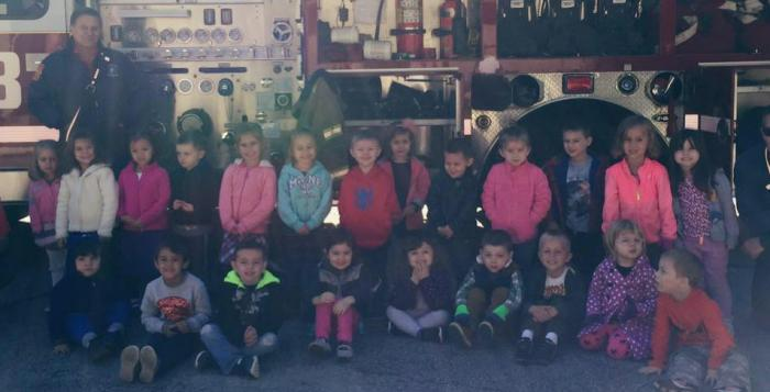 Firemen, fire truck, and children