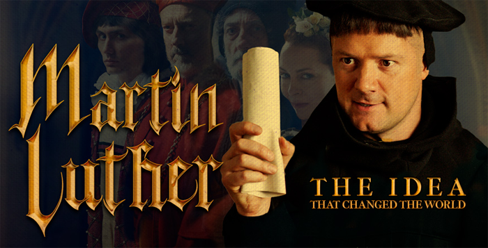 Martin Luther holding a scroll