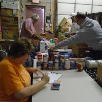 sorting cans at food pantry